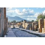 The remains of Via Dell'Abbondanza, a street once filled with shops and eateries for all residents of the city, as currently seen in the ruins of Pompeii